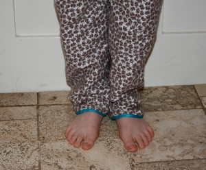 The boy with curly toes and lovely pjs